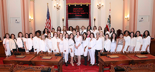 Wearing white and paying tribute to the 100th anniversary of the 19th Amendment.